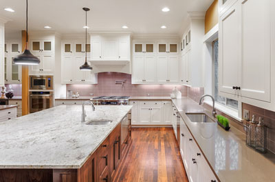 Debating Between Granite & Quartz Kitchen Countertops?  Let Us Help You Decide.